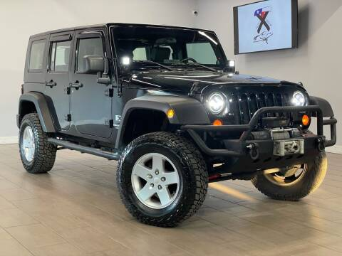 2007 Jeep Wrangler Unlimited for sale at TX Auto Group in Houston TX
