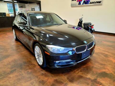 2013 BMW 3 Series for sale at Driveline LLC in Jacksonville FL