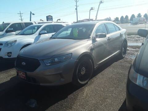 2013 Ford Taurus for sale at BARNES AUTO SALES in Mandan ND