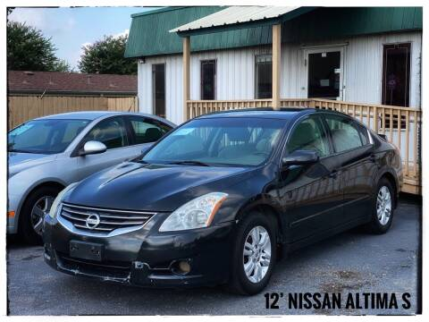 2012 Nissan Altima for sale at ASTRO MOTORS in Houston TX