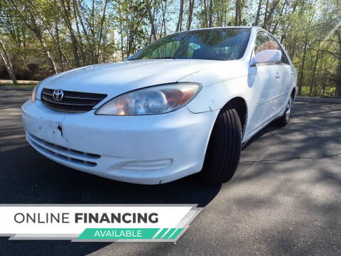 2004 Toyota Camry for sale at StarCity Motors LLC in Garden City ID