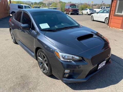 2016 Subaru WRX for sale at BERKENKOTTER MOTORS in Brighton CO