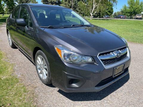 2013 Subaru Impreza for sale at BELOW BOOK AUTO SALES in Idaho Falls ID