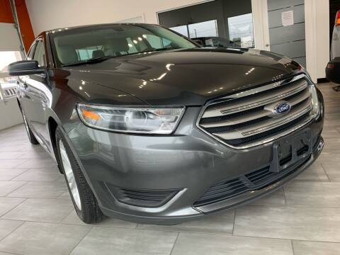 2016 Ford Taurus for sale at Evolution Autos in Whiteland IN