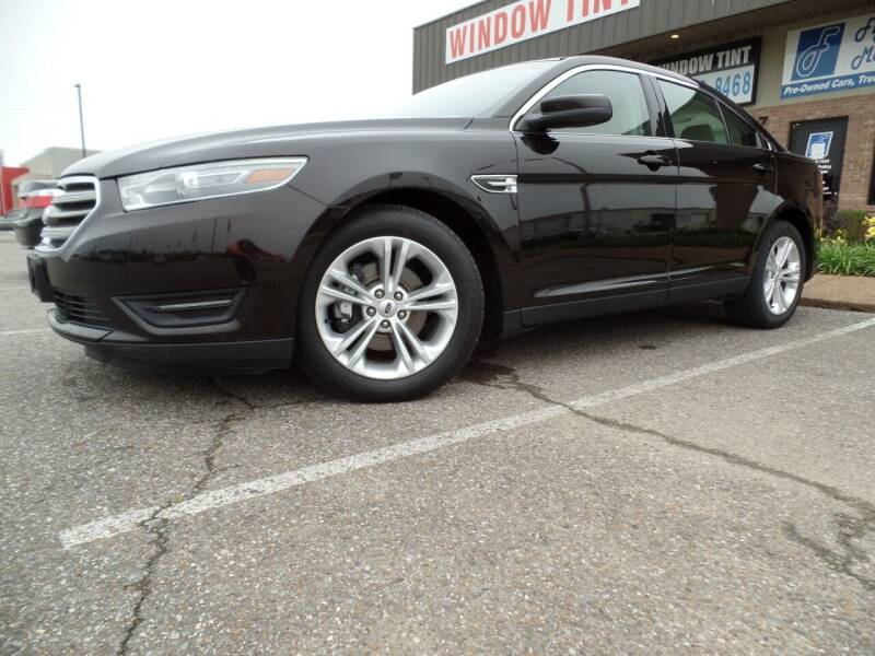 2014 Ford Taurus for sale at Flywheel Motors, llc. in Olive Branch MS