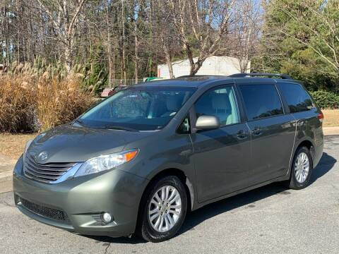 2011 Toyota Sienna for sale at Triangle Motors Inc in Raleigh NC