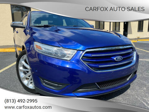 2014 Ford Taurus for sale at Carfox Auto Sales in Tampa FL