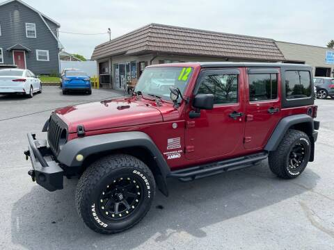 2012 Jeep Wrangler Unlimited for sale at MAGNUM MOTORS in Reedsville PA