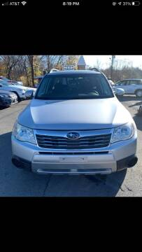 2010 Subaru Forester for sale at MCQ SALES INC in Upton MA