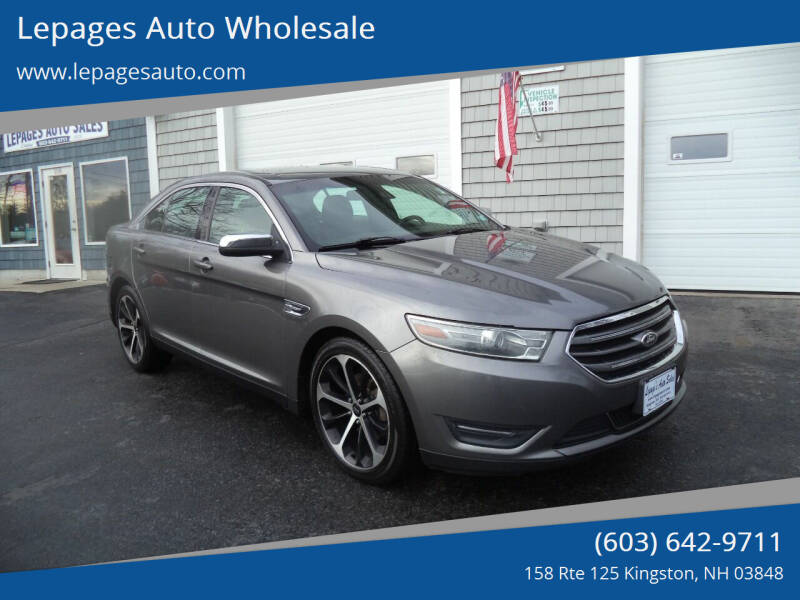 2014 Ford Taurus for sale at Lepages Auto Wholesale in Kingston NH