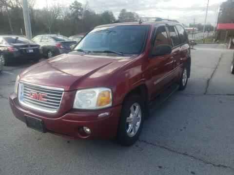 2007 GMC Envoy for sale at Credit Cars LLC in Lawrenceville GA