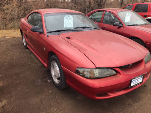 1995 Ford Mustang for sale at BARNES AUTO SALES in Mandan ND