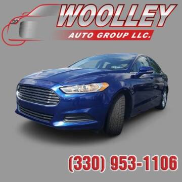2014 Ford Fusion for sale at Woolley Auto Group LLC in Poland OH