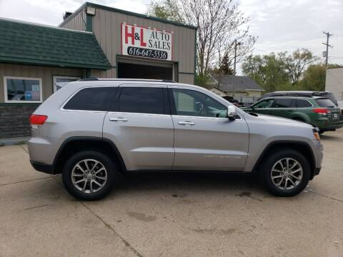 2014 Jeep Grand Cherokee for sale at H & L AUTO SALES LLC in Wyoming MI