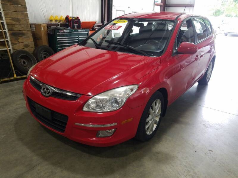 2009 Hyundai Elantra for sale at Hometown Automotive Service & Sales in Holliston MA