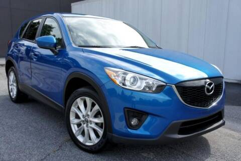 2014 Mazda CX-5 for sale at CU Carfinders in Norcross GA