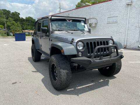 2016 Jeep Wrangler Unlimited for sale at Consumer Auto Credit in Tampa FL
