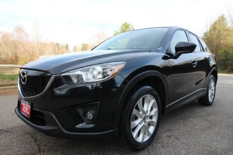 2014 Mazda CX-5 for sale at Oak City Motors in Garner NC