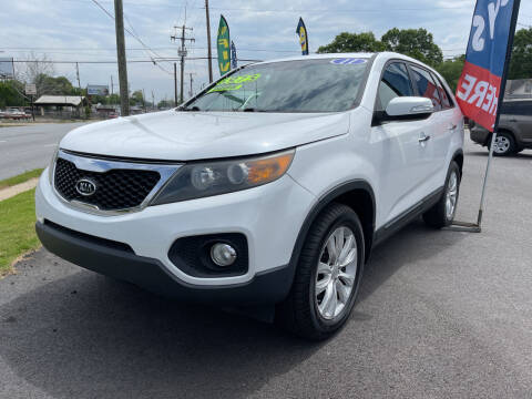 2011 Kia Sorento for sale at Cars for Less in Phenix City AL