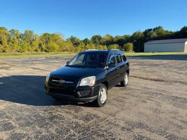 2009 Kia Sportage for sale at Caruzin Motors in Flint MI