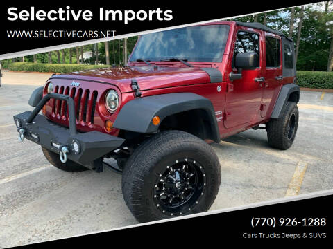 2013 Jeep Wrangler Unlimited for sale at Selective Imports in Woodstock GA
