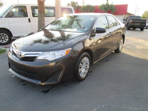 2014 Toyota Camry for sale at Affordable Auto Motors in Jacksonville FL