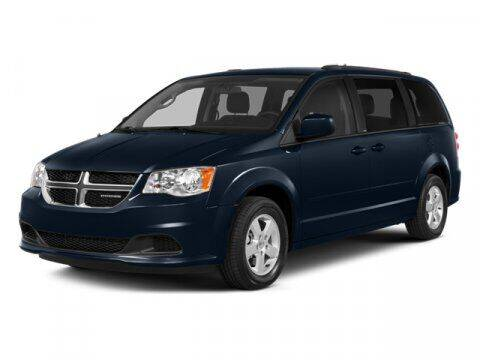 2014 Dodge Grand Caravan for sale at STG Auto Group in Montclair CA