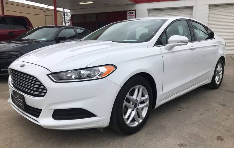 2014 Ford Fusion for sale at FAST LANE AUTO SALES in San Antonio TX