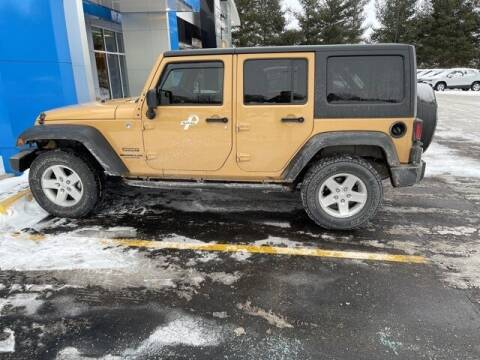 2014 Jeep Wrangler Unlimited for sale at Bob Clapper Automotive, Inc in Janesville WI