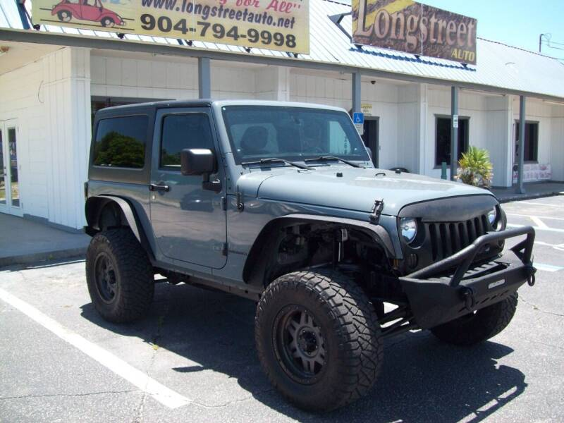 2014 Jeep Wrangler for sale at LONGSTREET AUTO in St Augustine FL