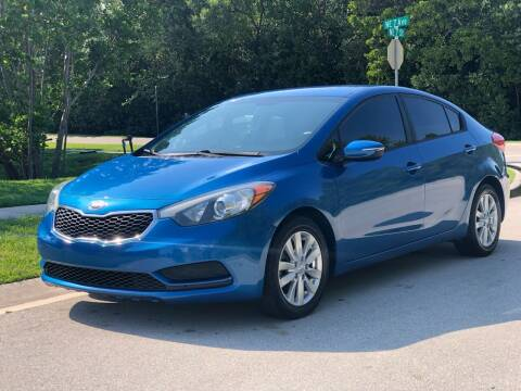 2014 Kia Forte for sale at L G AUTO SALES in Boynton Beach FL