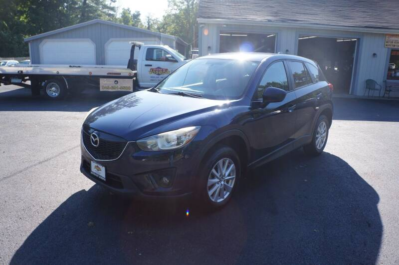 2014 Mazda CX-5 for sale at Autos By Joseph Inc in Highland NY