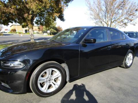 2015 Dodge Charger for sale at KM MOTOR CARS in Modesto CA