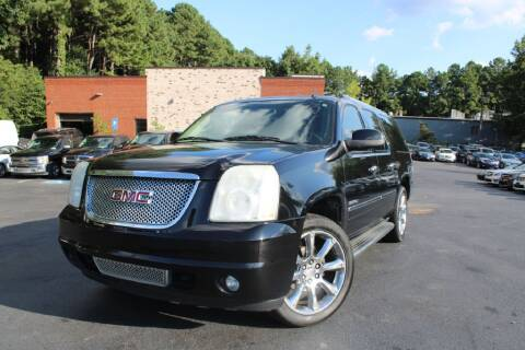 2010 GMC Yukon XL for sale at Atlanta Unique Auto Sales in Norcross GA