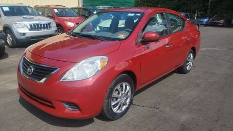 2013 Nissan Versa for sale at GA Auto IMPORTS  LLC in Buford GA