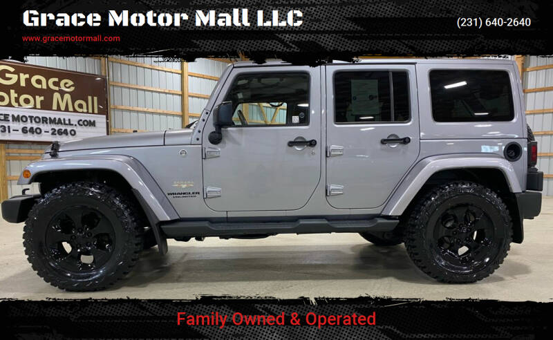 2015 Jeep Wrangler Unlimited for sale at Grace Motor Mall LLC in Traverse City MI