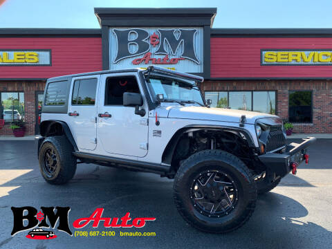 2011 Jeep Wrangler Unlimited for sale at B & M Auto Sales Inc. in Oak Forest IL