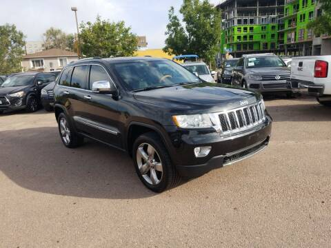 2012 Jeep Grand Cherokee for sale at BERKENKOTTER MOTORS in Brighton CO