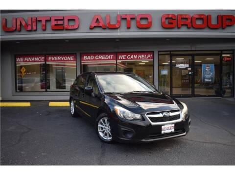 2012 Subaru Impreza for sale at United Auto Group in Putnam CT