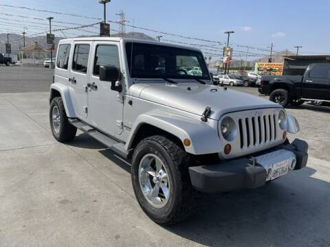 2011 Jeep Wrangler Unlimited for sale at Los Compadres Auto Sales in Riverside CA