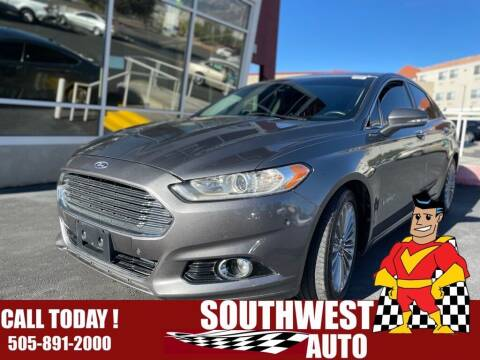2013 Ford Fusion Hybrid for sale at SOUTHWEST AUTO in Albuquerque NM