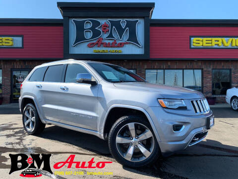 2015 Jeep Grand Cherokee for sale at B & M Auto Sales Inc. in Oak Forest IL