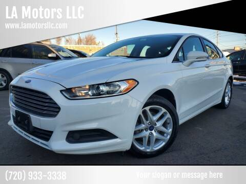 2014 Ford Fusion for sale at LA Motors LLC in Denver CO