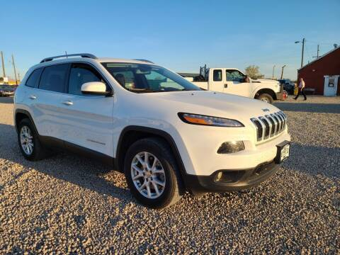 2017 Jeep Cherokee for sale at BERKENKOTTER MOTORS in Brighton CO