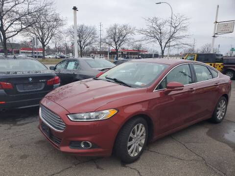 2014 Ford Fusion for sale at J & J Used Cars inc in Wayne MI