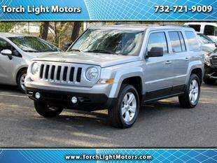 2014 Jeep Patriot for sale at Torch Light Motors in Parlin NJ