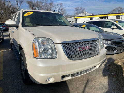 2012 GMC Yukon XL for sale at Unique Auto Group in Indianapolis IN