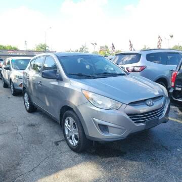 2013 Hyundai Tucson for sale at America Auto Wholesale Inc in Miami FL