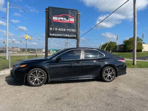 2020 Toyota Camry Hybrid for sale at SIRIUS MOTORS INC in Monroe OH