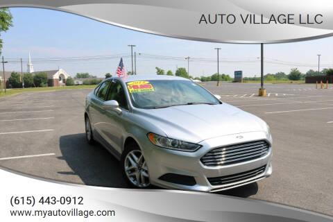 2014 Ford Fusion for sale at AUTO VILLAGE LLC in Lebanon TN